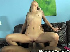 Faye is a petite white girl who loves a big, black cock. She gets on top and takes every inch of that black pole in her tight, shaved pussy.