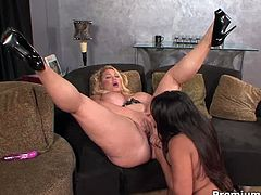 Experienced bbw slut and her younger lesbian latina friend are having fun on the couch! Watch them toying and fucking with a strapon!