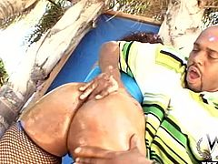 This sexy black chick has a booty that won't quit, her man rubs oil all over that sweet ass. Watch as she sucks his his thick black, cock. He bends her over and fucks her hard from behind. What a slut she is.