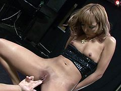 Kinky Japanese lady with cute face gets her shaved kitty fondled with big dildo. Then dude brutally finger fucks tight Asian pussy making his bitch reach squirting orgasm.