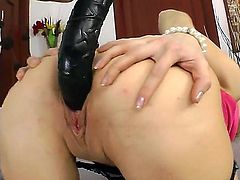 Young and sweet babe named Ann Marie gets a big black toy in her asshole