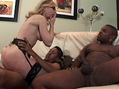 Interracial threesome with a very experienced milf Nina Harley. She is going to be sucking two huge black cocks and then they fuck her.