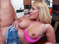 Slutty light haired babe with nice boobs gets her cunt fucked hard and sucks the dick on the kitchen table. Watch this bitch in Naughty America xxx video.