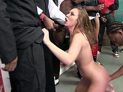 Katie Kox has a name that says it all. She opens up wide and sucks every black dick in the room during a crazy interracial gangbang.