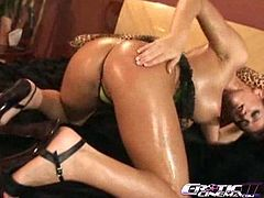 Get a hard dick watching this brunette babe, with gigantic boobs wearing a thong, while she touches herself covered in oil until she has an orgasm.