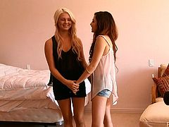 Admirable long-haired girls Cassie and Chloe are having fun indoors. They change their clothes in the bedroom and show their nude bodies to each other.