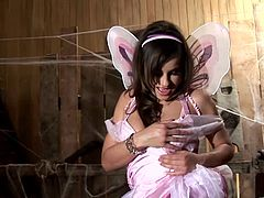 Get a hard dick watching this brunette butterfly, with big knockers and a cute costume, while she touches her shaved pussy softly.