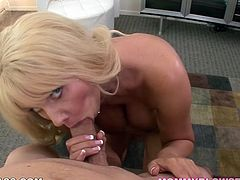 Busty porn star Karen Fisher looks straight up the camera while sucking hard cock balls deep. She also gives hot titjob in high-quality porn clip.