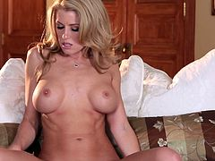 Sweet blonde Randy Moore takes her lingerie off and demonstrates her fake tits and hot butt for the cam. Then she fingers her twat and moans loudly.