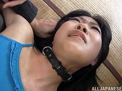 This cute Japanese babe writhes every which way, as her master dominates her with genital and asshole stimulation. She bends over with her ass in the air and he sticks his fingers in her butt, while spreading her pussy lips wide. After his fingers, he soon moves on to using a sex toy in her butt.