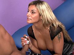 Klarisa Leone is a busty blonde milf sucking on this guy's big black cock before being fucked silly as you hear her moan.