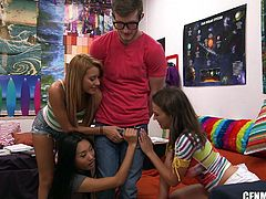 It's time for a break from studying. These girls ask their nerdy friend to take his cock out of his pants, so they can see and all takes turns rubbing it. He's naked, but they won't take their clothes off. Fun begins!
