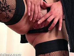 Wet and Pissy brings you a hell of a free porn video where you can see how a hot blonde slut pisses after dildoing her sweet cunt while wearing black stockings.