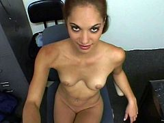 A slim chick takes off her clothes and plays with her pussy in an office. She is doing this to seduce her colleague. Of course he is interested in this babe. So, they go to a store and fuck there on a floor.