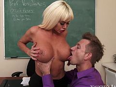 Her huge fake boobs will drive you crazy as well as her big appetizing ass. Dude drills blonde slut right on the teachers table and she moans like sex insane.