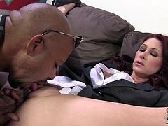 Slutty chick Tiffany Mynx is playing dirty games with a black stud indoors. She sucks and rubs the dude's boner and then gets her shaved cunt fucked in missionary position.