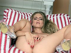 A gorgeous blonde slut spreads her legs and fingers her pussy while showing off her amazing body. Check it out right here!