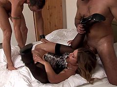 A sexy girl in nylon stockings and a corset toys her wet cunt with a black dildo. Then this chick has a threesome sex. Olivia gets fucked in both holes simultaneously.