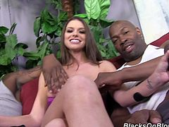 Long-haired bombshell Brooklyn Chase is getting naughty with two black men in backstage clip. She gives an interview and gets her boobs kneaded.
