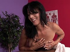 Massage gets her pretty horny and more than curious to feel this black tool deep in her steamy cunt