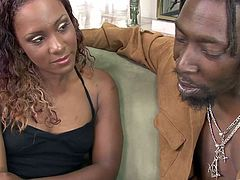 This sexy black woman oils up her body and works up a sweat as she goes for a ride on this black guy's big cock and cums her brains out.