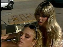 Debi Diamond sunbathes outdoors lying on a lounge chair. Stacy Nichols brings a strapon as a present. Of course these blondes want to test the new toy right away. So, Deby gets fucked in her mouth and a pussy with the strapon.