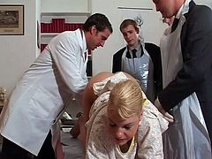 Filthy porn scene featuring seductive blonde MILF is presented by Lust Cinema. Three man wearing suits play with her shaved pussy and tight anus using smooth sex toys.