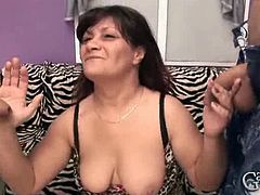 Mature chick is ready to get involved in a banging with two horny and younger dudes. Watch as they stick their meaty schlongs deep into her mouth to satisfy her.