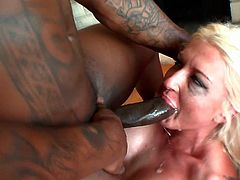 Busty and dumpy blond MILF Leya Falcon gets her anus fucked hard by black stud
