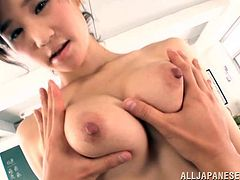 Awesome Japanese teacher Ki Hanyuu is having fun with a guy in a classroom. She shows her big natural boobs to the dude and then drives him crazy with a titjob.