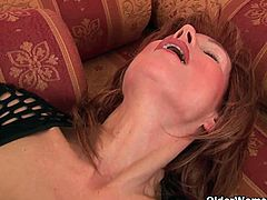 This mature redhead lady is one horny bitch, who likes to play with herself when no one is around. She is so horny that she can not resist the desire to finger her pussy and pump it with her huge dildo. Watch this sultry mature lady fucking herself with a huge dildo. Enjoy!
