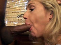 Make you have a look at this hardcore scene where the busty mature blonde Wanda Lust sucks on this guy's hard cock as well as titty fucking him with her big tits before being fucked in her kitchen.