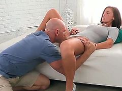 Whitney broadens her legs and gives Johnny perfect access to her wet kitty. The man kisses it and then begins licking it as if it is candy lolly. It is unforgettable oral sex!