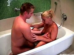 This young guy takes a bath with granny Rita. He plays with her huge natural titties and sucks on her nipples. She gets horny and sucks on his rock hard cock.