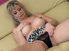 Samantha Marty is a busty blonde cougar who puts on a solo show without toys. She stuffs her cunt with her fingers only, but that proves to be very effective for her.