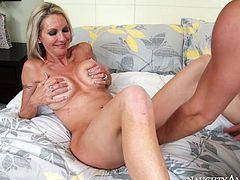 Buxom cougar Emma Starr rides Johnny Castle's dick in cowgirl position