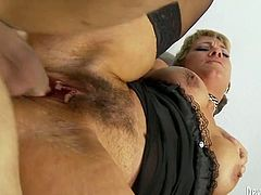 This incredibly perverted whore just loves to fuck and she needs a crazy, break-the-couch type of fucking. She climbs on top of her lover's dick and rides him passionately in reverse cowgirl position. They they fuck in sideways position.