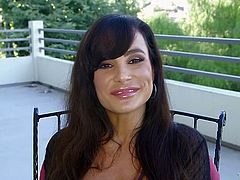 Stunning MILF Lisa Ann has got some of the most massive titties that you'll ever find! And she does have a fine ass. Scorching brunette puts on an awesome show for her lover. She strips nude and then she starts masturbating in front of him.