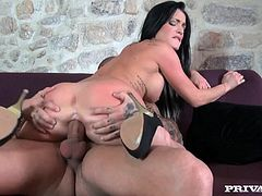 Take a nice look at this brunette pornstar, with big knockers wearing black high heels, while she goes really hardcore over a couch.