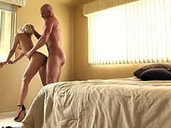This dude knows how to make his woman happy. He bends this chick over and fucks her tight pink pussy from behind. A few positions later she rides his swollen dick in cowgirl position.