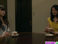 Risa Murakami has her hands tied up at her back and she's forced to suck multiple cocks and take them inside her hairy cunt, including fake cocks. Another babe joins her.