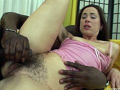 Impossibly rapacious dark haired whore posed missionary style on sofa and spread her legs apart. That feverish African boy attacked her incredibly haired pussy and fucked it hard. A bit later she set to swallow that big sloppy cock. Watch this ugly pussy in Fame Digital sex video!