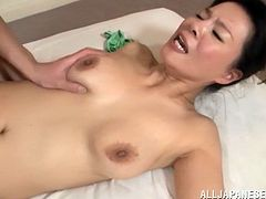 A luscious Asian MILF licks balls and gets cowgirl fucked