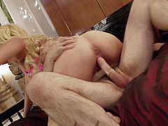 Get excited watching this blonde pornstar, with giant gazongas wearing a pink bra, while she goes really hardcore with a tattooed dude.