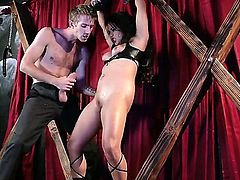 Young slim stud Danny D with huge meaty cock enjoys fucking pretty tight ass asian doll Lana Violet while she hangs tied up for wooden frame until she has loud squirting orgasm.