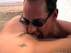 This fucker eats this bitch's pussy out at the beach and then they fuck hard, check it out right here! It's hot as fuck!