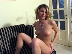 Lovely blonde pussy playing babe teases with her sweet pussy lips and nasty toy in a hot solo masturbation porn video she rubs her little tits then put  a massive dildo in her pussy!