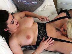 Hot blooded blond gal with big boobs sat on sofa with her legs spread apart and got her pussy licked by hot brunette sex doll. Have a look at that fancy lesbo sex in When Girls Play porn clip!