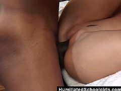 The salacious Ebony dude needs to get his large penis slurped. The slender brunette gets that massive prick shoved deep inside of her mouth right before that horny dude sticks it in her.