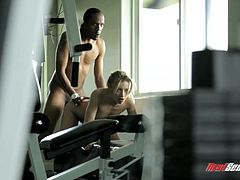 Have a good time by watching this blonde babe, with a nice ass and natural boobs, while she gets banged hard by a big black cock in the gym.